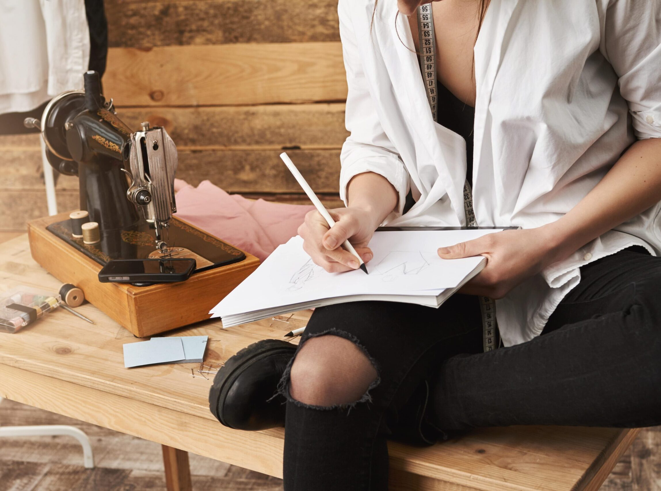 https://doradcy365.pl/wp-content/uploads/2020/11/when-hobby-become-real-work-cropped-shot-of-creative-female-designer-of-clothes-sitting-on-table-near-sewing-machine-in-her-workshop-making-notes-or-planning-new-design-for-her-clothing-line-min-scaled-e1605608829168.jpg